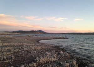 Elephant Butte Lake shoreline with sunset